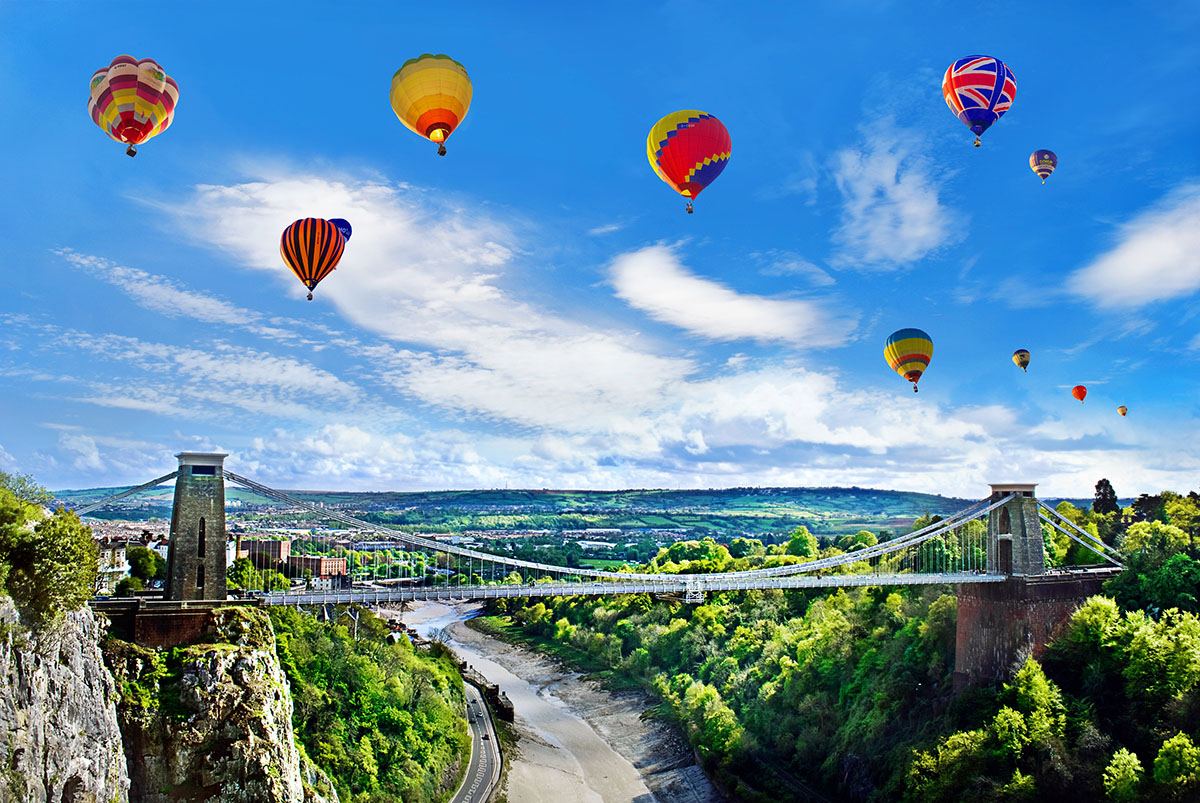 suspension bridge with balloons at the balloon fiesta