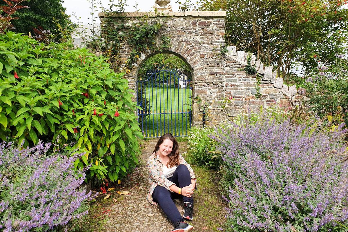 Sitting in a garden in Clovelly, North Devon