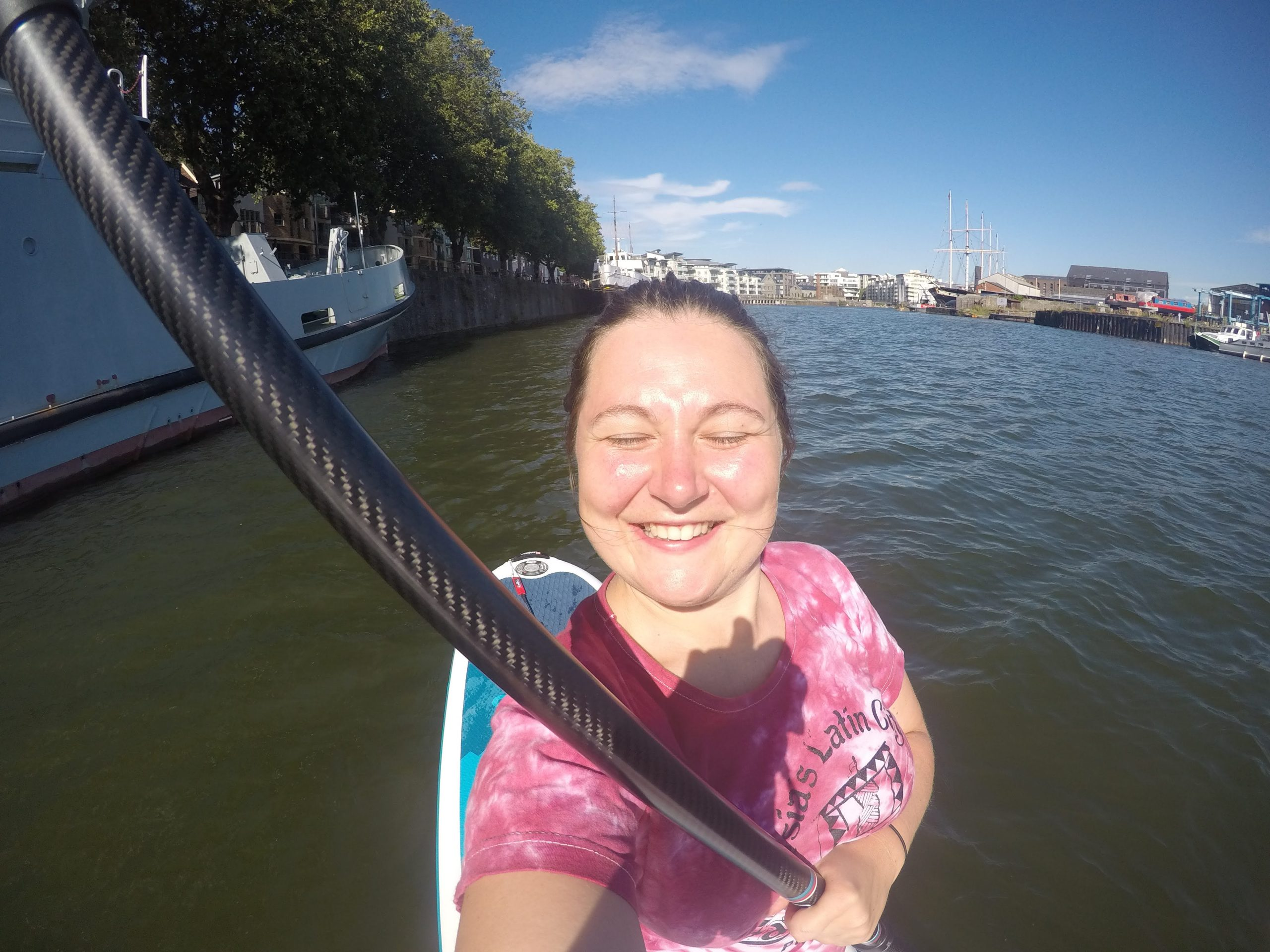 Girl stand up paddleboarding on River Avon in Bristol