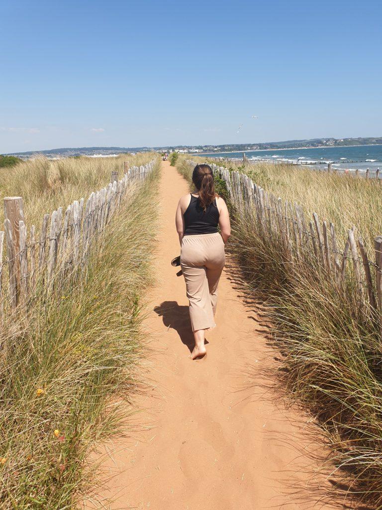 Girl walking to Dawlish Warren Beach