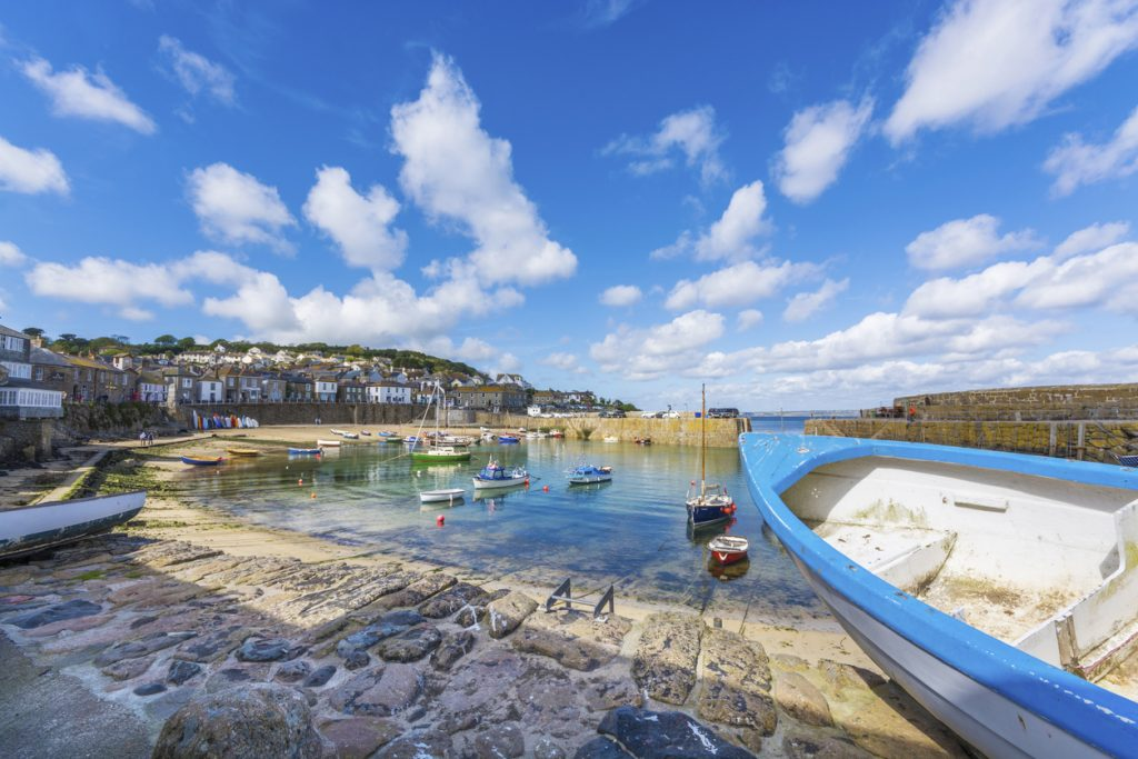 boats in traditional fishing harbour of Mousehole at Cornwall