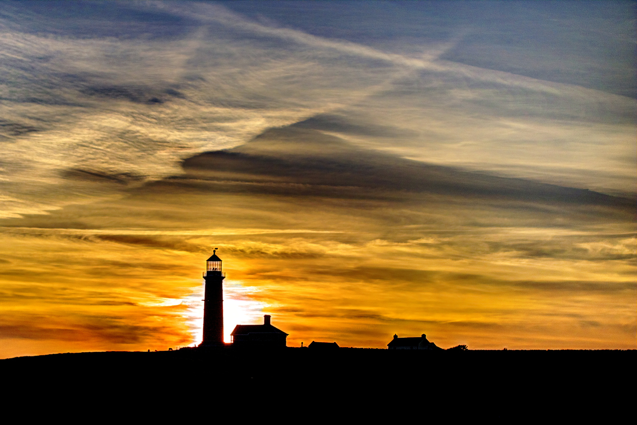 Silhouette of the Old Light lighthouse on Lundy Island at sunset