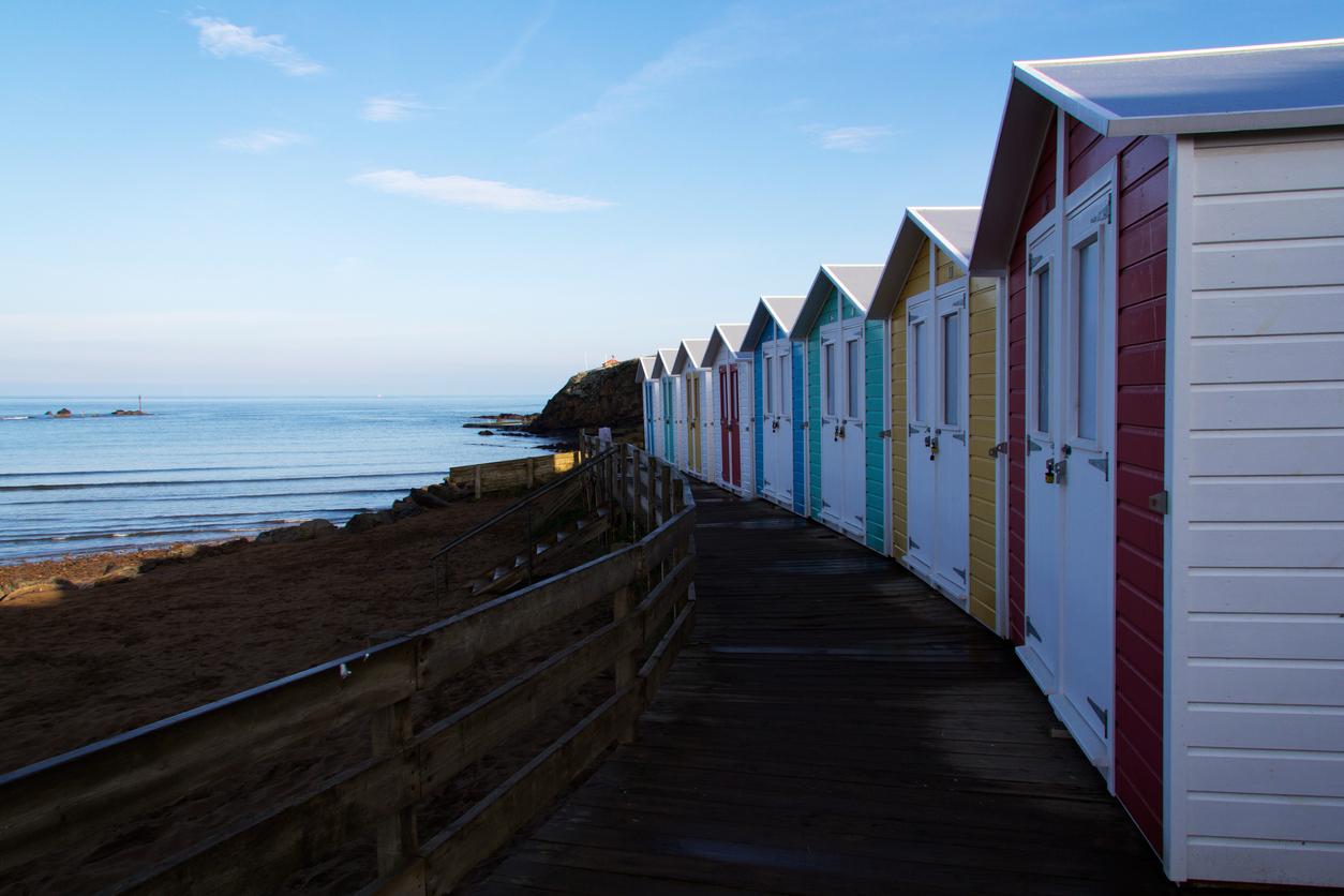 Beach huts at dawn by the beach at Bude, Cornwall