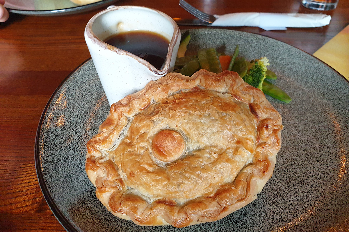 Pie and gravy at Jamaica Inn near Bodmin in Cornwall, South West England