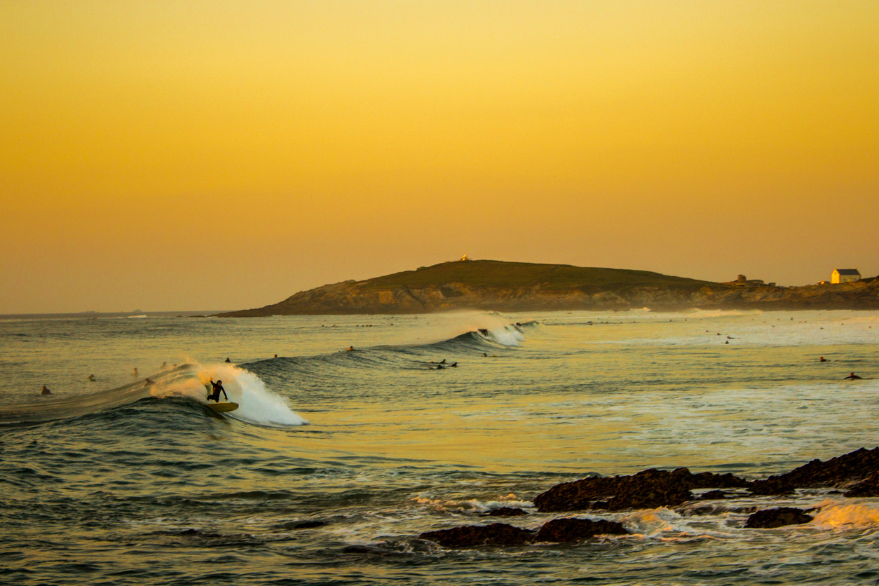 Surfing at sunset on Fistral Beach, Cornwall