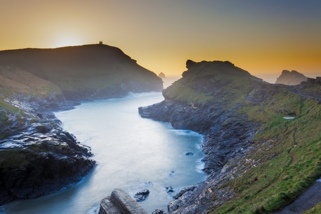 A misty sunset at Boscastle harbour entrance in Cornwall, South West England