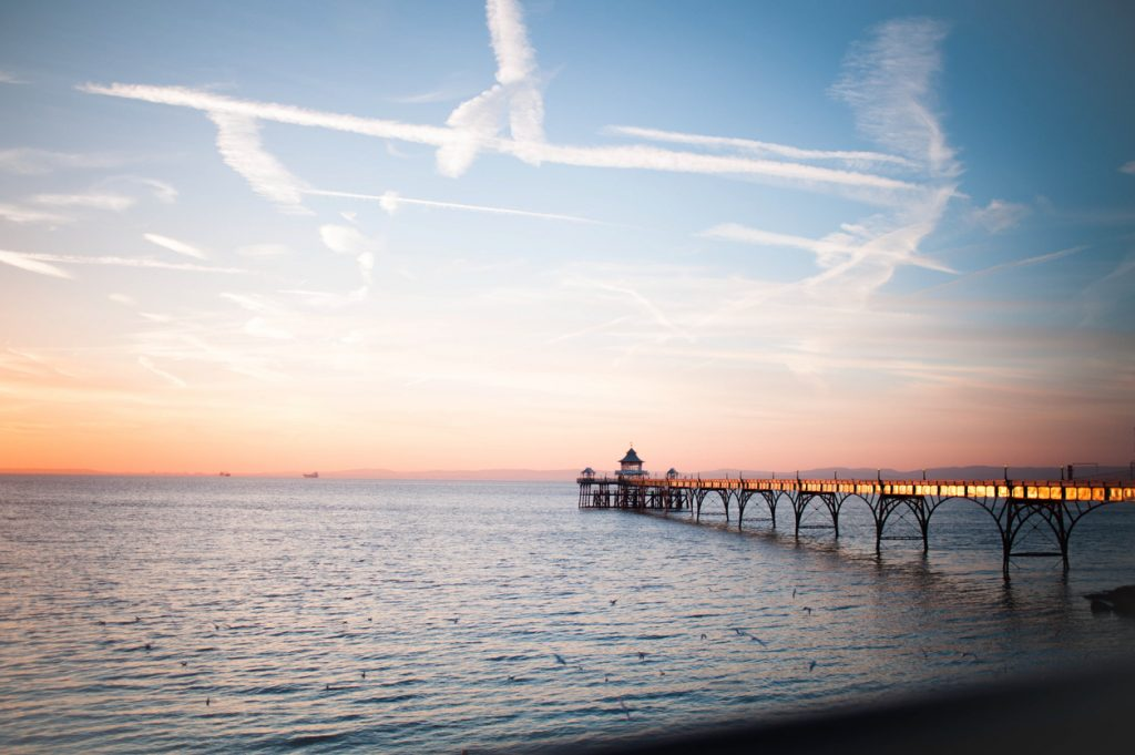 Looking out to Clevedon pier across the sea at sunset