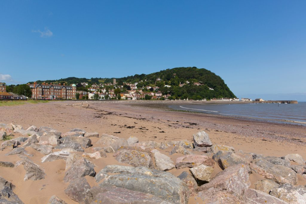 Minehead Somerset England UK beach and seafront towards the harbour in summer with blue sky on a beautiful day