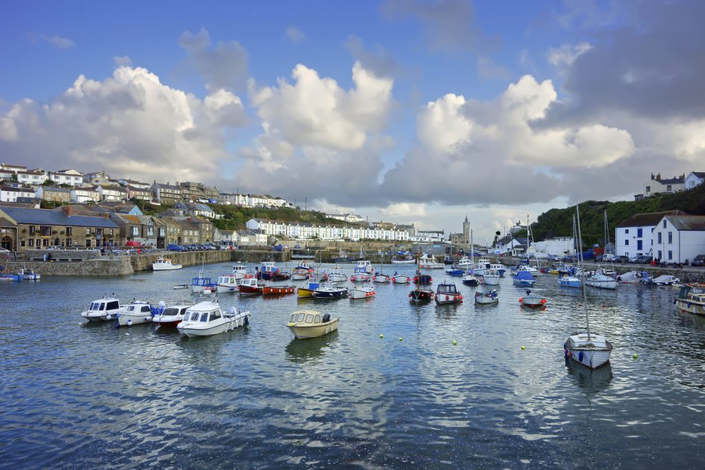 Twilight and soft evening light over moored fishing boats in the inner harbour of Porthleven, Cornwall, United Kingdom