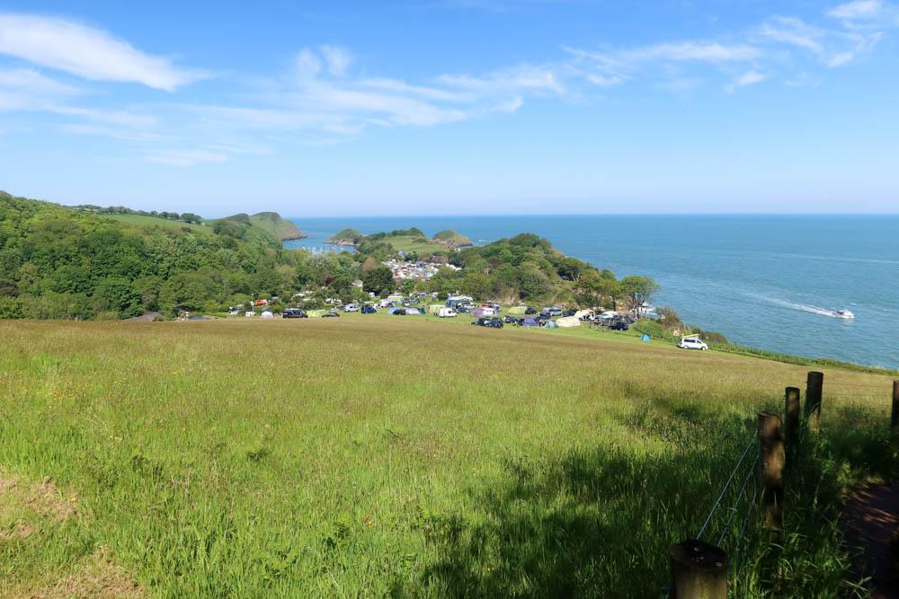 Coastal campsite with sea in background