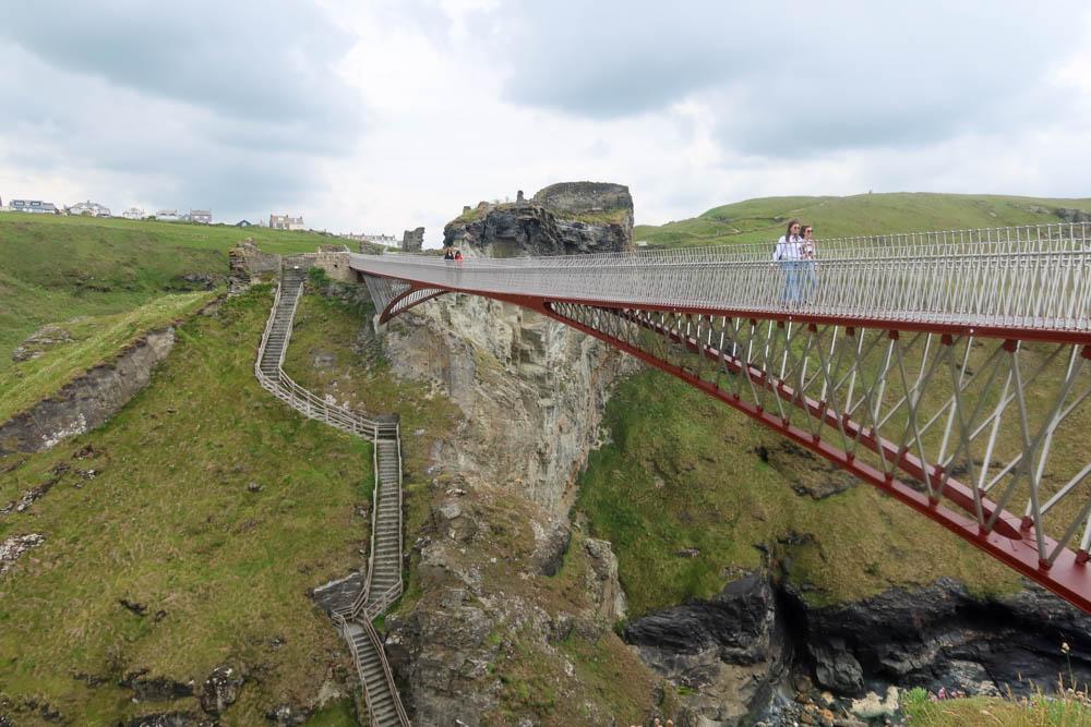 Tintagel Castle with people walking over bridge