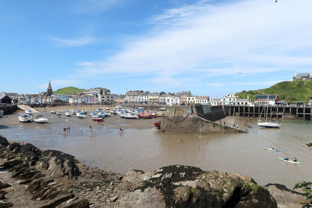 Ilfracombe harbour with boats and walkers