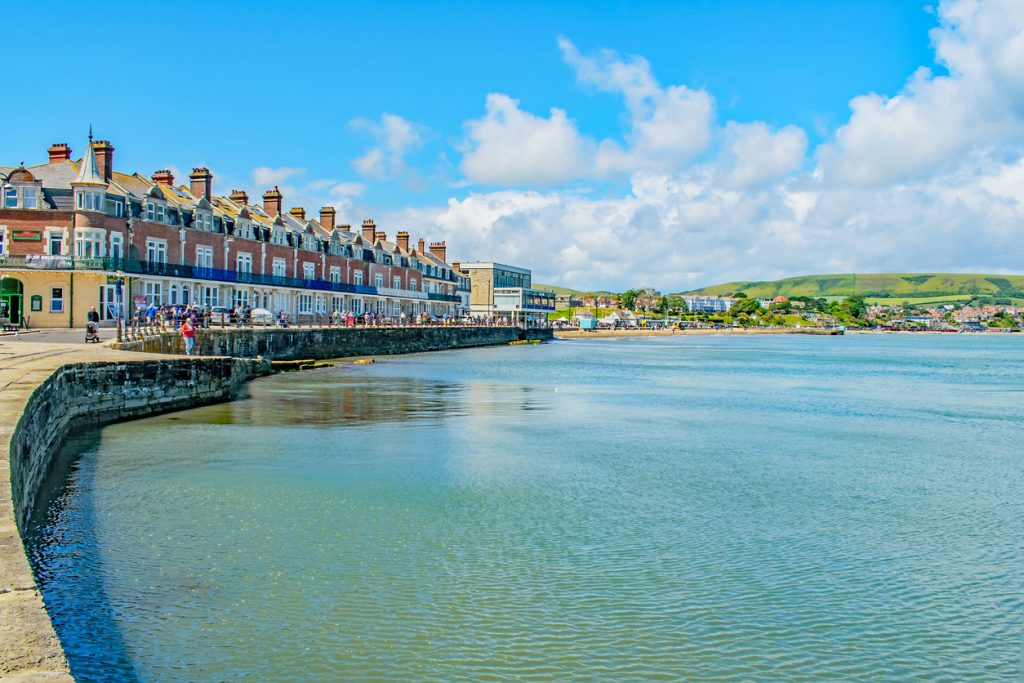 The rippling waters at Swanage Bay shimmer on a summers day