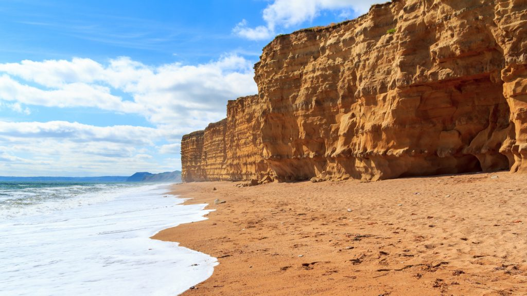 Beach and cliffs at Burton Bradstock Dorset England UK